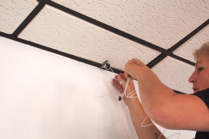 Then the cables were clipped to the metal frames holding the ceiling tiles